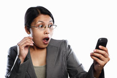Businesswoman surprised using video call Stock Photos