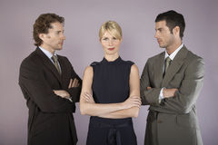 Businesswoman Surrounded By Businessmen Royalty Free Stock Photos
