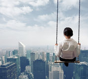 Businesswoman on a swing Stock Images