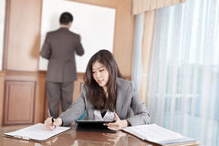 Businesswoman and tablet Royalty Free Stock Image