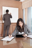 Businesswoman and tablet Stock Image