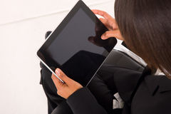 Businesswoman with tablet. On white background Stock Images