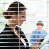 Businesswoman with tablet. Computer in an office Royalty Free Stock Photo