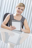 Businesswoman On Tablet Computer in Office Stock Image
