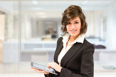 Businesswoman with tablet computer in the office Stock Image
