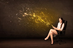 Businesswoman with tablet and energy explosion on background Stock Image