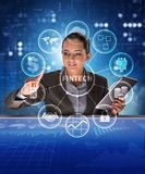 Businesswoman with tablet in financial technology fintech concep. T royalty free stock images