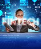 Businesswoman with tablet in financial technology fintech concep. T royalty free stock photo
