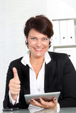 Businesswoman with tablet giving thumbs up Royalty Free Stock Photography