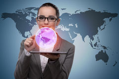 The businesswoman with tablet in global business concept Stock Photo