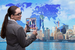 The businesswoman with tablet in global business concept Royalty Free Stock Photo