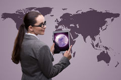 The businesswoman with tablet in global business concept Stock Photography