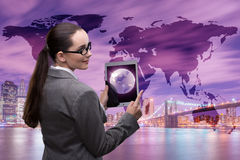 The businesswoman with tablet in global business concept Stock Image