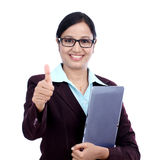 Businesswoman with tablet and making thumbs up gesture Stock Image