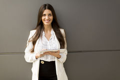 Businesswoman with tablet in the office Royalty Free Stock Photos