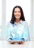 Businesswoman with tablet pc comuter and globe Stock Images