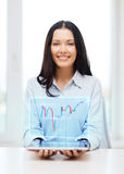 Businesswoman with tablet pc and forex chart Royalty Free Stock Image