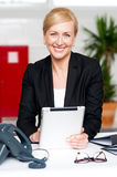 Businesswoman with tablet pc at her desk Stock Photography