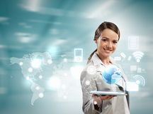 Businesswoman with tablet pc. Image of businesswoman with tablet pc against high-tech background Stock Photography