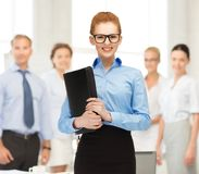 Businesswoman with tablet pc in office Royalty Free Stock Image