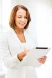 Businesswoman with tablet pc in office Stock Photography
