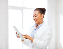 Businesswoman with tablet pc in office Royalty Free Stock Photography