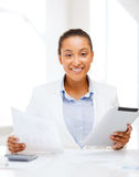 Businesswoman with tablet pc in office Stock Photos