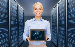 Businesswoman with tablet pc over server room Royalty Free Stock Photos