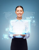 Businesswoman with tablet pc and world hologram Stock Photos