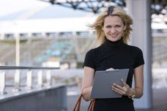 The businesswoman with a tablet Stock Images