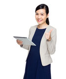 Businesswoman with tablet and thumb up Stock Photos
