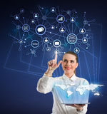 Businesswoman  with tablet and  virtual icons Stock Images