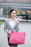Businesswoman take a credit card Stock Photo