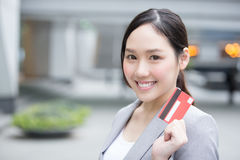 Businesswoman take a credit card Stock Photography