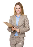 Businesswoman take note on clipboard Stock Photo