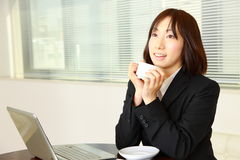 Businesswoman takes a cofee break Stock Image