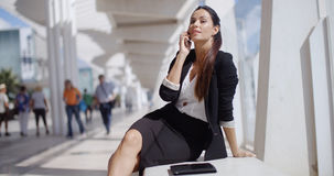 Businesswoman taking a call on her mobile Stock Photography