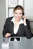 Businesswoman taking a call on her mobile Stock Photo