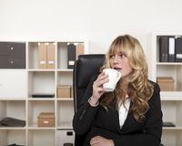 Businesswoman taking a coffee break Stock Image