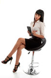 Businesswoman taking dictation or notes. A young pretty smartly dressed businesswoman or stenographer writing notes or shorthand in a notepad Royalty Free Stock Photo