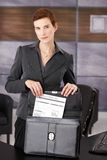 Businesswoman taking document from briefcase Royalty Free Stock Image