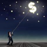 Businesswoman taking a dollar symbol Stock Photo