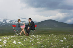 Businesswoman Taking Interview Of Candidate In Field Stock Photo