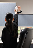 Businesswoman taking note from next cubicle Stock Photos