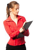 Businesswoman taking notes. On white background Royalty Free Stock Image