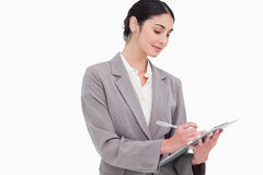 Businesswoman taking notes. Against a white background Royalty Free Stock Image