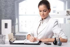 Businesswoman taking notes Stock Photo