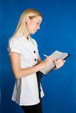 Businesswoman Taking Notes. Beautiful young businesswoman taking notes Stock Photo