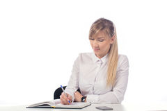Businesswoman  taking notes. Portrait of smiling  business woman, isolated on white background Royalty Free Stock Photography