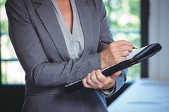 Businesswoman taking notes. In a restaurant Stock Photography